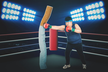 Overweight man is fighting with a cigarette