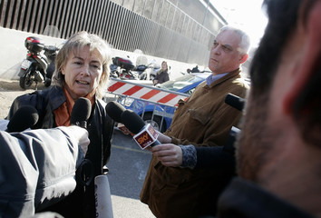Italian journalist Sgrena talks to reporters as she leaves the court at the end of hearing in Rome