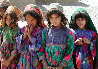 AFGHAN CHILDREN WAIT AT UNITED NATIONS REGUGEE CAMP IN HEART.