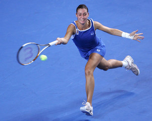 Italy's Pennetta plays shot to Belgium's Henin-Hardenne in the final of the Fed Cup tennis tournament in Charleroi