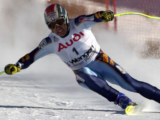 KRISTIAN GHEDINA OF ITALY TAKES A CURVE DURING THE LAUBERHORN DOWNHILL WORLD CUP RACE IN WENGEN.