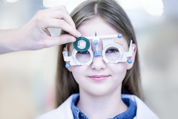 Girl wearing trial frame