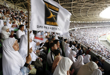 Supporters of the Prosperous Justice Party  gather at Jakarta's main stadium