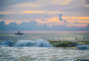 Private sport fishing boat just off the Florida coast at sunrise.