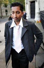 RAF reservist Mohisin Khan is seen outside the High Court in London after losing his appeal against the RAF.