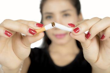 Woman hand breaking cigarette