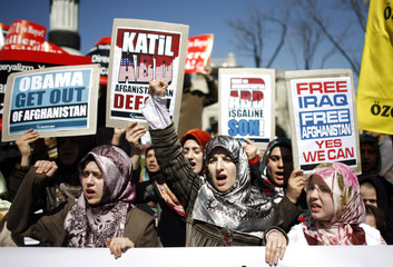 Demonstrators shout slogans against U.S. President Obama during protest in Istanbul