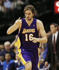 Lakers' Gasol of Spain heads up court after hitting shot against Mavericks during second half in Dallas