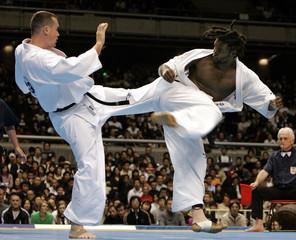 Brazil's Teixeria kicks Soukup of Czech Republic during finals of World Open Karate Tournament in Tokyo