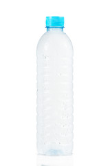 cold water bottle with many drops on white background