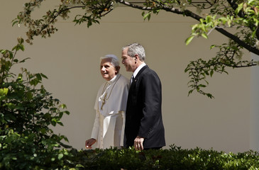 Pope Benedict XVI and U.S. President George W. Bush walk to the Oval Office at the White House in Washington
