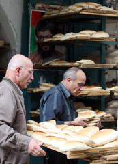 Palestinians buy bread inside market as they prepare to celebrate Eid al-Fitir in Nablus