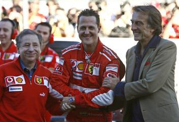 Schumacher shakes hands with team manager Todt and Ferrari's President Montezemolo during the Ferrari World Event at the Monza racetrack in northern Italy