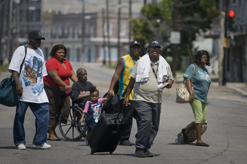 Residents walk towards an evacuation center in New Orleans