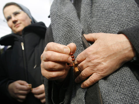 Romanian Catholic nuns pray during a protest against the construction of a modern office building in Bucharest