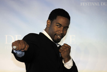 """Actor Michael Jai White poses during a photocall for the film """" Black Dynamite """" at the 35th Deauville American film festival in Deauville"""