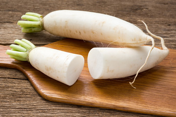 freshness and ripe chinese radish on wooden chopping block