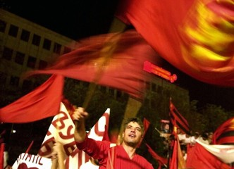 SUPPORTER OF MACEDONIAN COALITION RULING PARTY WAVES FLAG IN SKOPJE.