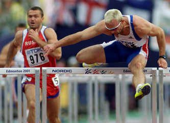 DVORAK OF CZECH REPUBLIC IN 110 METER HURDLES EVENT OF MENS DECATHLON.