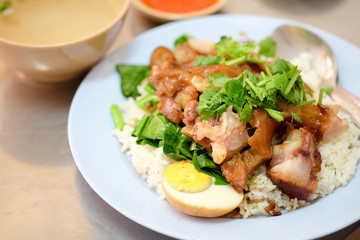 Stewed pork leg with egg and on rice on the table