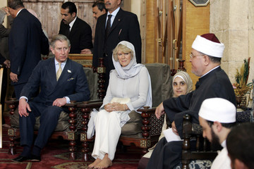 Britain's Prince Charles and his wife Camilla, Duchess of Cornwall, listen to Quranic lesson in Cairo