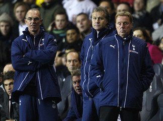 Tottenham Hotspur manager Redknapp stands with his assistant coaches during English League Cup match against Liverpool in London