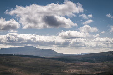 Ingleborough, one of the three peaks in the Yorkshire Dales, with Morecambe bay in the distance.