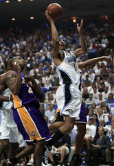 Orlando Magic guard Courtney Lee goes to the basket past Los Angeles Lakers guard Kobe Bryant during Game 5 of their NBA Finals basketball series in Orlando