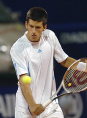 Serbia's Djokovic hits the ball to Czech Vanek during their ATP Croatia Open quarter-final tennis match in Umag