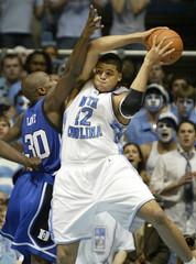North Carolina's Sean May pulls down a rebound against Reggie Love.