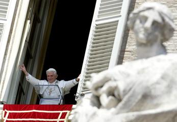 Pope Benedict XVI gestures during his Angelus prayer at the Vatican