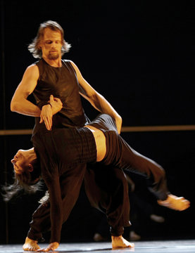 """Members of the Rootlessroot company from Greece perform during the International Festival of Dance in Urban Landscapes """"Dancing Days"""" at Space in Movement CCCB in central Barcelona"""