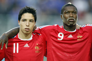 France's Nasri and club team mate Cisse listen to the national anthem before a friendly soccer match against Ecuador at Stade des Alpes in Grenoble