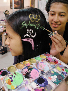 OLYMPIC LOGO IS PAINTED ON THAI WOMAN'S HAIR IN BANGKOK.