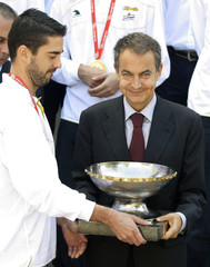 Spain's Prime Minister Rodriguez Zapatero holds the Eurobasket trophygiven to him by team captain Navarro during their meeting at La Moncloa palace in Madrid