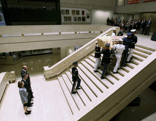 Former U.S. first lady Lady Bird Johnson's casket is brought to lie in repose at the Lyndon B. Johnson Presidential Library in Texas