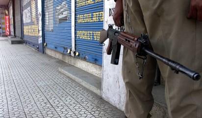 INDIAN SOLDIER ON GUARD DURING STRIKE IN SRINAGAR.