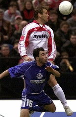 BARANOV OF SPARTAK MOSCOW AND MENTESHASHVILI OF SCONTO HEAD FOR THE BALL IN MOSCOW.