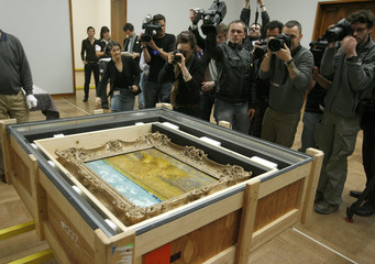 Media take pictures a transport box containing the painting 'Wheatfield with Sheaves' of late Dutch artist van Gogh at the Kunstmuseum Basel in Basel