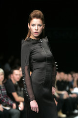 A model presents a creation by a group of designers representing Russian magazine Grazia, in Moscow
