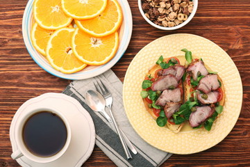 Open sandwich with pork greens and capers