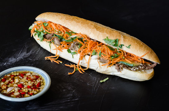 Vietnamese Pork Banh Mi Sandwich with Cilantro and carrot close-up