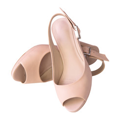 Female beige shoes pair isolated.