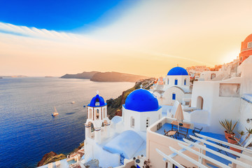 Aluminium Prints Santorini Beautiful Santorini sunset scenery, traditional white architecture, Santorini island, Oia village, Greece, Europe. Santorini is famous and popular summer vacation romantic resort.
