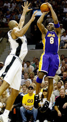 KOBE BYRANT OF THE LOS ANGELES LAKERS SHOOTS OVER SPURS DUNCAN.