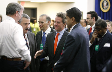 Geithner talks with attendees at the Jobs and Economic Growth forum at the White House in Washington