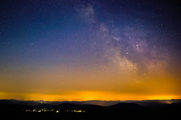 Astro Landscape with the Milky Way as seen from the Luitpold Tower in the Palatinate Forest in Germany.