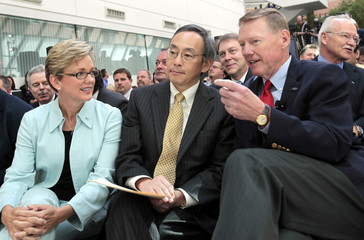 Ford Motor Co. President and CEO Mulally talks with U.S. Energy Secretary Chu and Michigan Governor Granholm during news conference in Dearborn