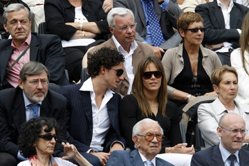 France's swimmers Manaudou and Stasiulis are seen during the men's final at the French Open tennis tournament in Paris
