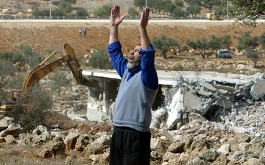 PALESTINIAN MAN SHOUTS AS A NEIGHBOUR'S HOUSE IS DEMOLISHED IN EASTJERUSALEM.